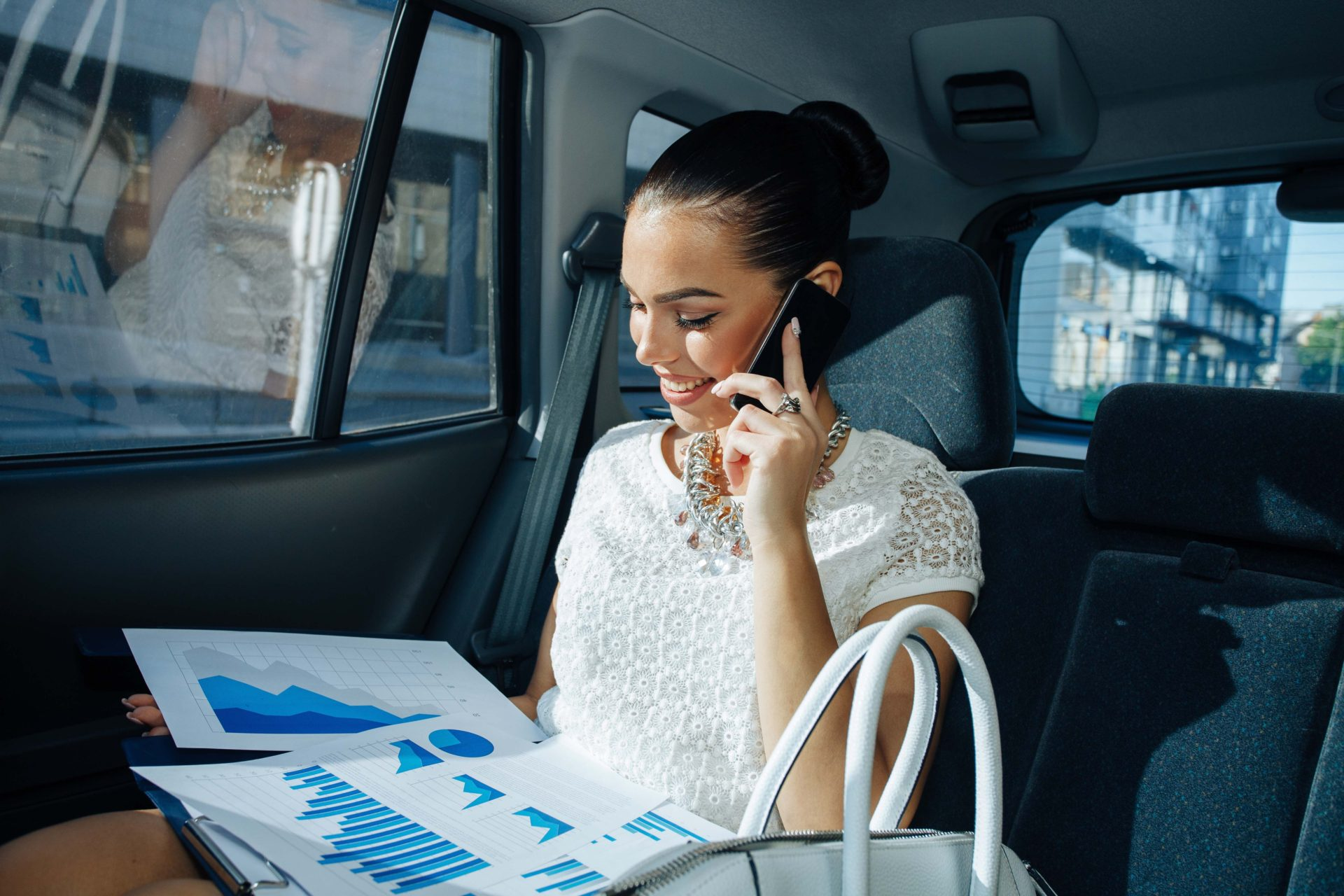 Business woman in black car