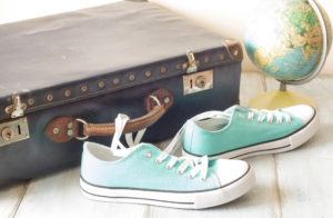 sneakers next to a suitcase - travel