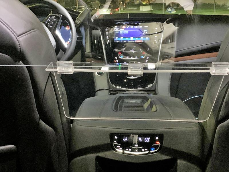 Plexiglass screen in chauffeur driven car d