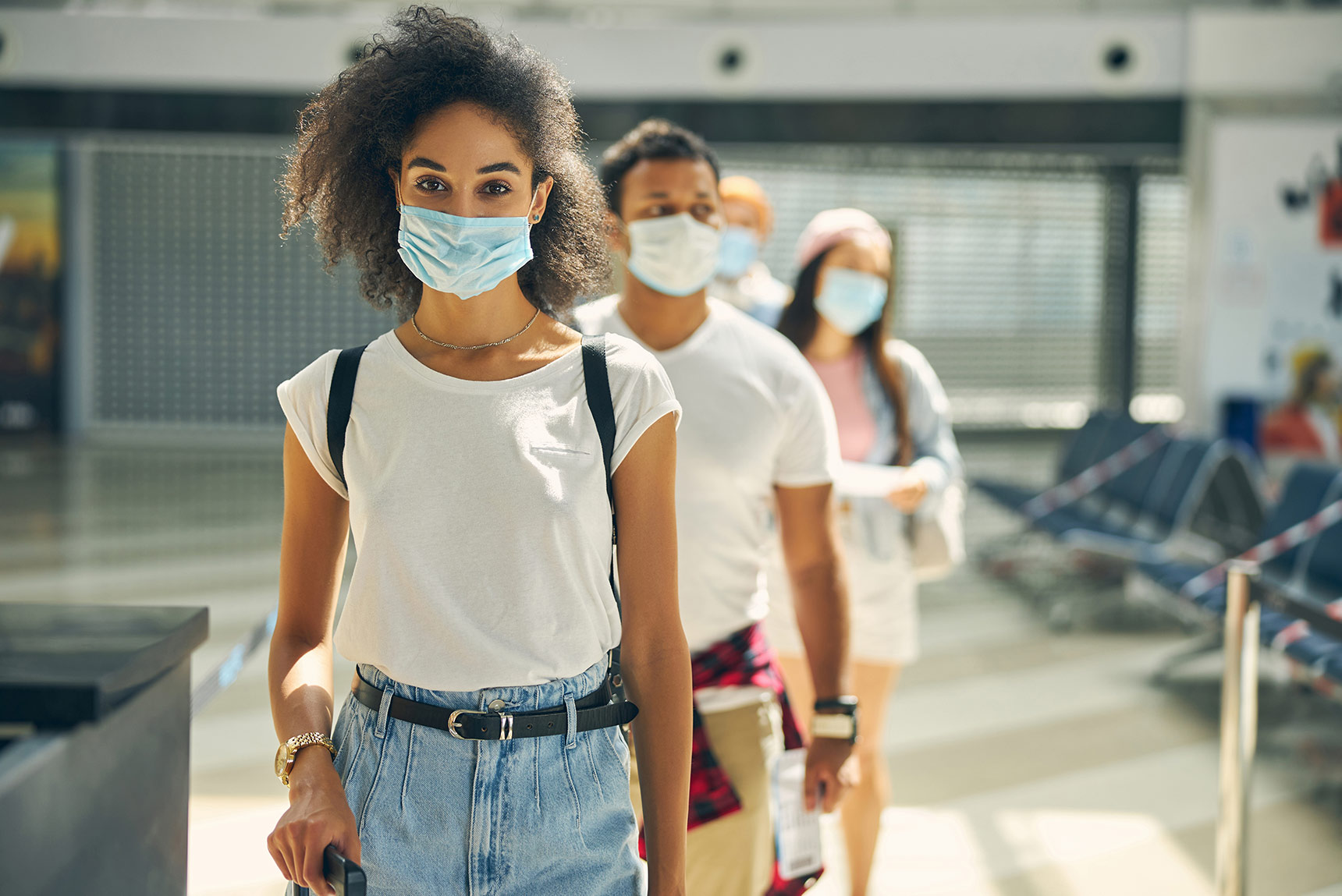 travelers with face mask